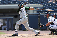 Fort Wayne TinCaps catcher Webster Rivas (8) follows through on his swing against the West Michigan Michigan Whitecaps during the Midwest League baseball game on April 26, 2017 at Fifth Third Ballpark in Comstock Park, Michigan. West Michigan defeated Fort Wayne 8-2. (Andrew Woolley/Four Seam Images)