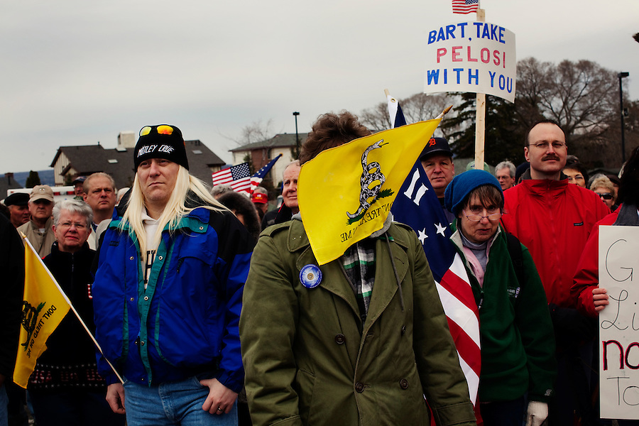 Petoskey, Michigan, April 10, 2010 - A crowd of about 150 Tea Party supporters in the parking lot of Emmet-Charlevoix County Fairgrounds during a Tea Party Express Rally, one of the many whistle stops added at the last minute to the tour that grew into a full blown rally. The TPX tour ended up with 12 stops in Michigan. .