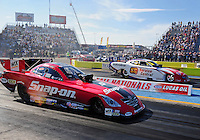 Sept. 24, 2011; Ennis, TX, USA: NHRA funny car driver Cruz Pedregon (near) against Johnny Gray during qualifying for the Fall Nationals at the Texas Motorplex. Mandatory Credit: Mark J. Rebilas-