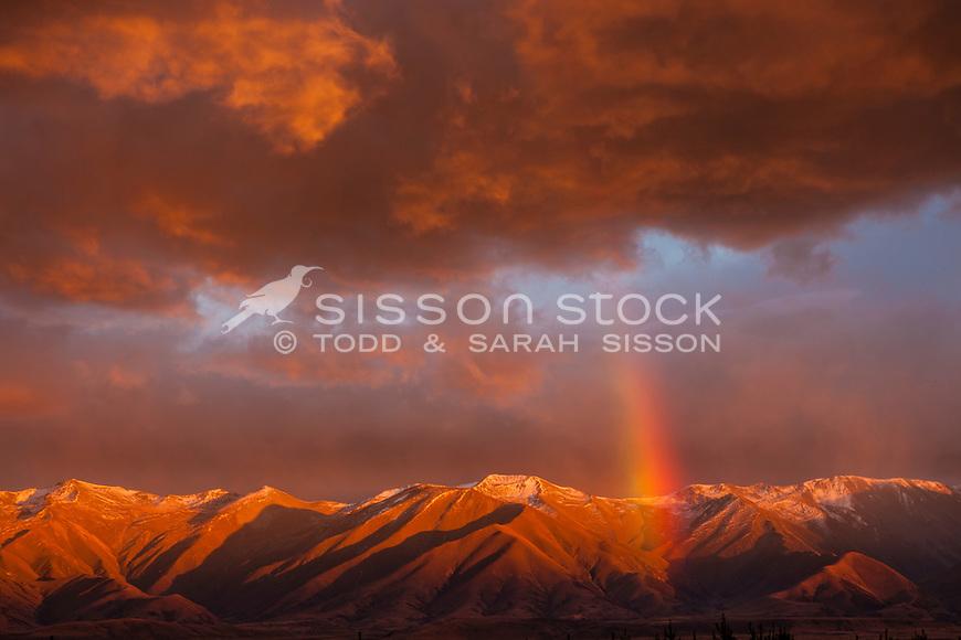 Intense rainbow &  red sunrise colour, over Ben Ohau range, Mackenzie basin NZ.