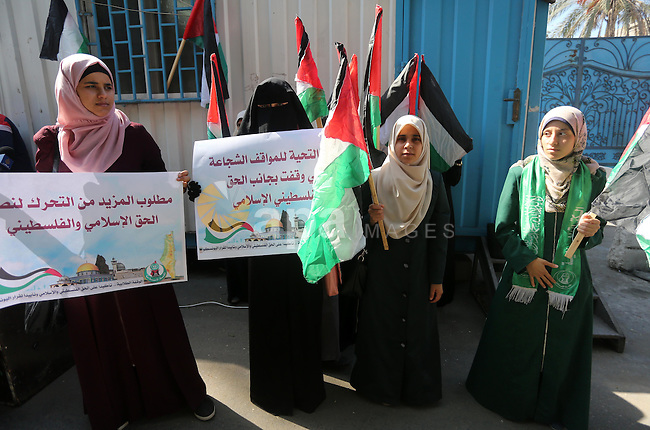 """Palestinian Hamas supporters take part in a rally in support of the decision of UNESCO on the Al-Aqsa Mosque in front of the headquarter United Nation """"UNSCO"""", in Gaza city, on October 20, 2016. Palestinian leaders have welcomed a decision by the United Nations cultural agency to adopt a resolution on occupied East Jerusalem that sharply criticises Israeli policies around the al-Aqsa Mosque compound, while Israel says it ignores Jewish ties to the key holy site. Photo by Mohammed Asad"""