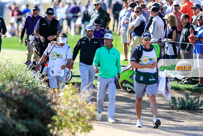 Gary Woodland (USA) Hideki Matsuyama (JPN) make there way to the 5th tee during the 2nd round of the Waste Management Phoenix Open, TPC Scottsdale, Scottsdale, Arisona, USA. 01/02/2019.<br /> Picture Fran Caffrey / Golffile.ie<br /> <br /> All photo usage must carry mandatory copyright credit (&copy; Golffile | Fran Caffrey)