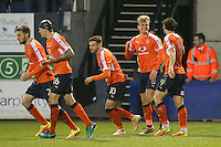 Cameron McGeehan of Luton Town (2nd right) celebrates after he scores his team's second goal of the game to make the score 2-1 during the Sky Bet League 2 match between Luton Town and Barnet at Kenilworth Road, Luton, England on 31 December 2016. Photo by David Horn.