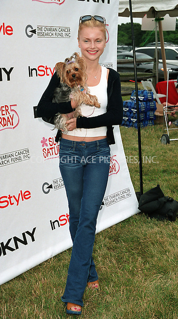 "Izabella Miko with her dog Layla (Laila) at the Fifth Annual ""Super Saturday"" designer sale and family event to benefit the ovarian cancer research fund. Water Mill, Long Island. July 27, 2002. Please byline: Alecsey Boldeskul/NY Photo Press.   ..*PAY-PER-USE*      ....NY Photo Press:  ..phone (646) 267-6913;   ..e-mail: info@nyphotopress.com"
