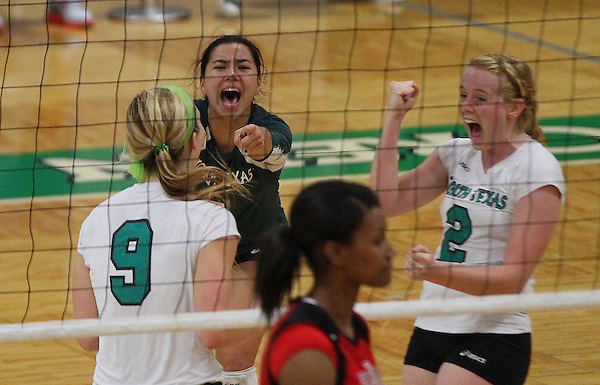Denton, TX - NOVEMBER 9: Shelby Tamura #8,Hanna Forst #9 and May Allen #2 of the University of North Texas Mean Green Volleyball celebrates a point against Arkansas State University at University of North Texas Volleyball Complex in Denton on November 9, 2012 in Denton, Texas. (Photo by Rick Yeatts)