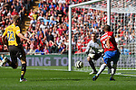 LONDON, ENGLAND - MAY 12: York City's Chambers crosses the ball to set up York City's second goal in the FA Carlsberg Trophy Final between York City and Newport County at Wembley Stadium on May 12, 2012 in London, England. (Photo by Dave Horn - Extreme Aperture Photography)