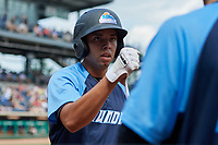 Trenton Thunder third baseman Danienger Perez (3) is congratulated by his teammates as he returns to the dugout after hitting a home run in the top of the fourth inning during a game against the Hartford Yard Goats on August 26, 2018 at Dunkin' Donuts Park in Hartford, Connecticut.  Trenton defeated Hartford 8-3.  (Mike Janes/Four Seam Images)