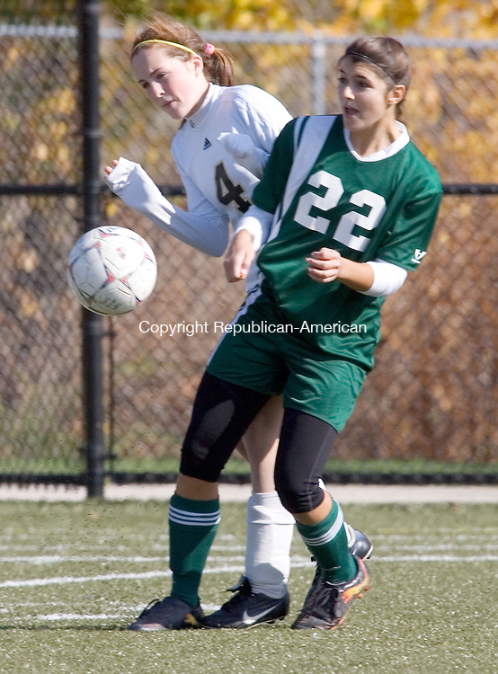 WATERBURY, CT. 30 October 2010-103010SV04--#4 Audra Blewitt of Woodland High battles with #22 Stephanie Varanelli of Holy Cross High during NVL soccer action in Waterbury Saturday.<br /> Steven Valenti Republican-American