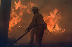 August 19, 1992 Angels Camp, California -- Old Gulch Fire— Firefighters do as much as they can while many of the houses in Northwood Estates are on fire. The Old Gulch Fire raged over some 18,000 acres, destroying 42 homes while threatening the Mother Lode communities of Murphys, Sheep Ranch, Avery and Forest Meadows.