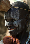 Old Woman with face painted, Mursi Tribe, Mago National Park, Lower Omo Valley, Ethiopia, portrait, person, one, tribes, tribal, indigenous, peoples, Southern, ethnic, rural, local, traditional, culture, primitive, smiling, laughing.Africa....