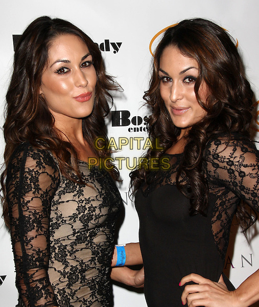 "BRIANNA GARCIA & STEPHANIE GARCIA. Lupus LA Raises Awareness with ""Get Lucky for Lupus"" held At Andaz Hotel, West Hollywood, California, USA..February 25th, 2010.half length black lace dress side hand on hip sisters twins family .CAP/ADM/KB.©Kevan Brooks/AdMedia/Capital Pictures."