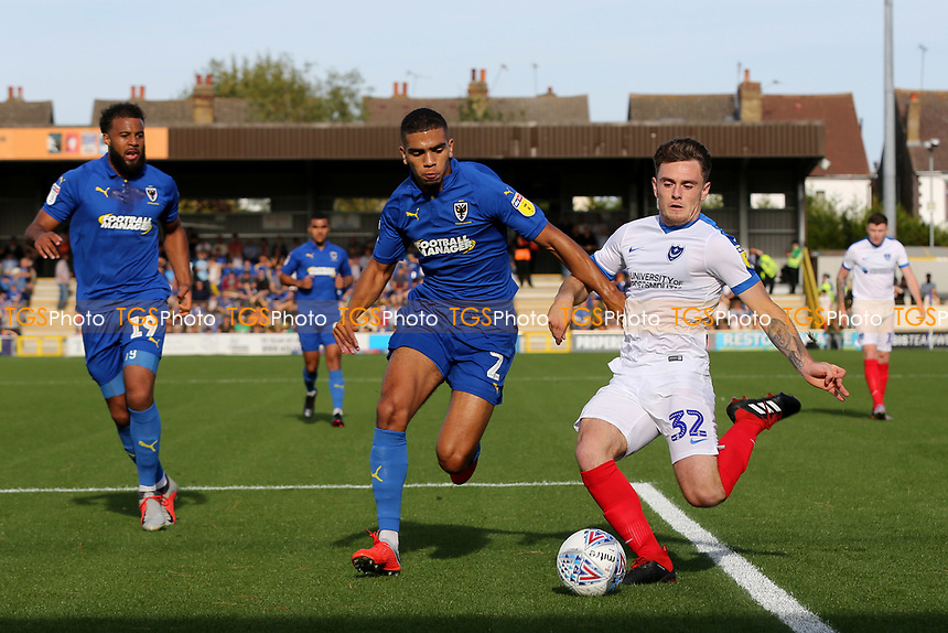 Ben Thompson of Portsmouth outpaces AFC Wimbledon's Tennai Watson during AFC Wimbledon vs Portsmouth, Sky Bet EFL League 1 Football at the Cherry Red Records Stadium on 13th October 2018