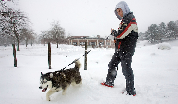 WATERBURY, CT. 08 March 2013-030813SV09-Sean Mead of Waterbury and his dog Kato brave the snow and go for a walk on Oronoke Road in Waterbury Friday..Steven Valenti Republican-American