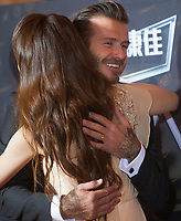 British footballer David Beckham embraces an unidentified female MC on the red carpet at the 18th Channel [V] China Music Awards and Asian Influential Power Grand Ceremony at the Venetian Macau Casino in Macau, China, 23 April 2014