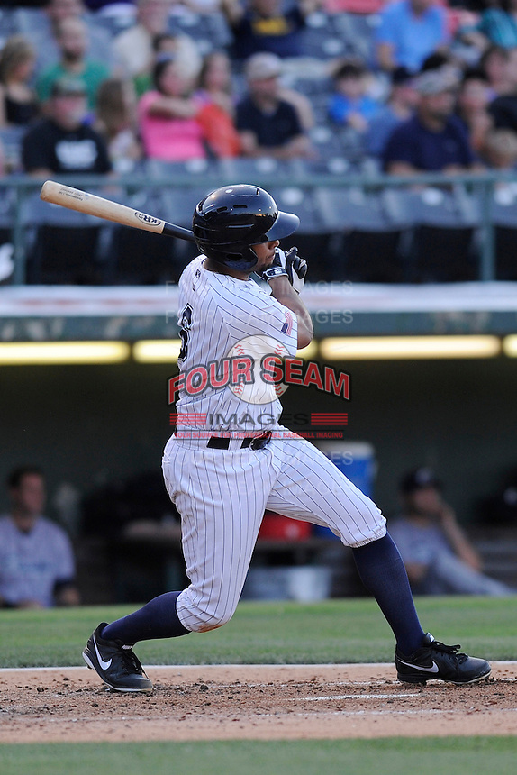 Shortstop Angel Sanchez (6) of the Charlotte Knights bats in a game against the Columbus Clippers on Saturday, June 15, 2013, at Knights Stadium in Fort Mill, South Carolina. Columbus won, 4-2. (Tom Priddy/Four Seam Images)