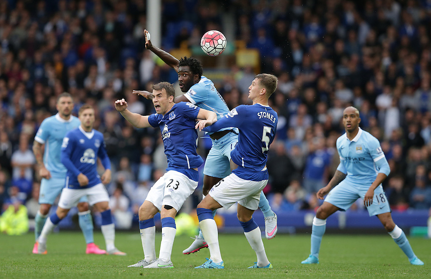 Everton's Seamus Coleman and John Stones battle with Manchester City's Wilfried Bony<br /> <br /> Photographer Stephen White/CameraSport<br /> <br /> Football - Barclays Premiership - Everton v Manchester City - Sunday 23rd August 2015 - Goodison Park - Liverpool<br /> <br /> &copy; CameraSport - 43 Linden Ave. Countesthorpe. Leicester. England. LE8 5PG - Tel: +44 (0) 116 277 4147 - admin@camerasport.com - www.camerasport.com
