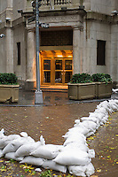 "Sandbags are used to protect the entrance to the closed New York Stock Exchange in New York on Monday, October 29, 2012. Hurricane Sandy continues its steady advance with heavy wind and rain. New York has shut down the schools, the transit system and the Holland and Hugh L. Carey Tunnels have been closed. Evacuations have been ordered in the ""Zone A"" areas including Battery Park City. (© Frances M. Roberts)"