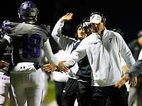 Fayetteville quarterback Hank Gibbs is congratulated by Head Coach Casey Dick after scoring touchdown  against Rogers Heritage at Gates Stadium, Rogers, AR on November 1, 2019 / Special to NWA Democrat Gazette David Beach