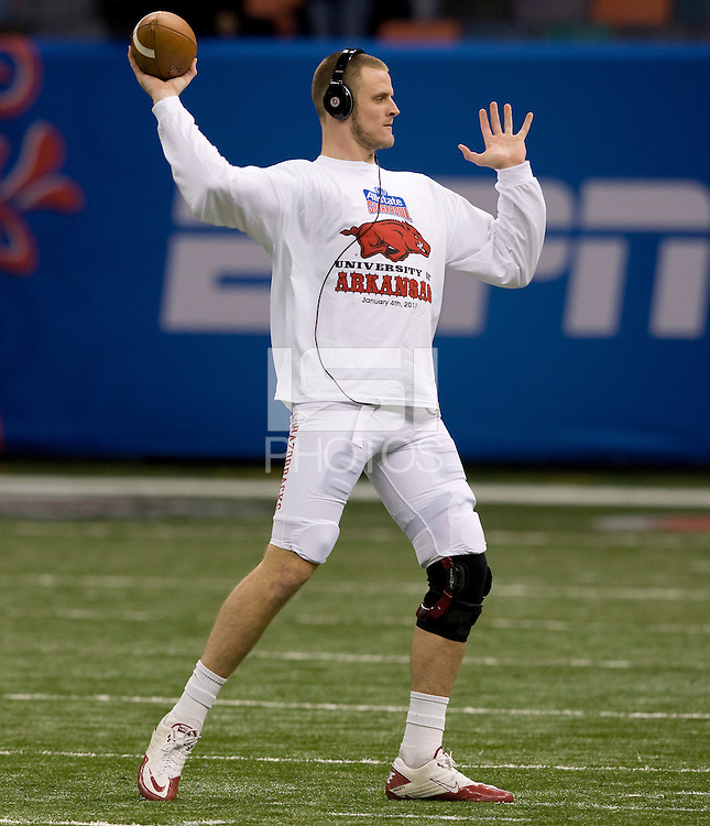 Ryan Mallett of Arkansas is pictured warming up before the game against Ohio State during 77th Annual Allstate Sugar Bowl Classic at Louisiana Superdome in New Orleans, Louisiana on January 4th, 2011.  Ohio State defeated Arkansas, 31-26.