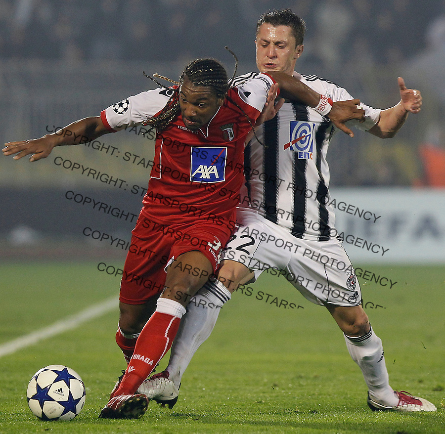 FC Braga player Alan, left is challenged by Partizan player Sasa Ilic, right, during their Group H UEFA Champions League match in Belgrade, Serbia, Wednesday, Nov. 3, 2010.  (Srdjan Stevanovic/Starsportphoto.com)