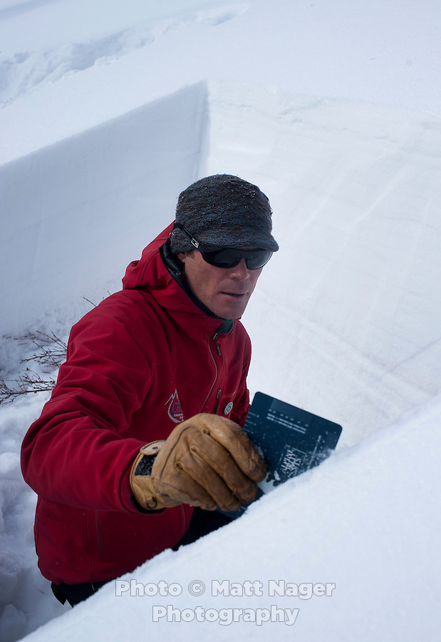 Colorado Avalanche Information Center (CAIC) Avalanche Forecaster Tim Brown (cq) smooths a square hole snow to see snow pack levels at Coon Hill, which stands about 11,150 feet in elevation, and evaluate what type of avalanches may occur in similar regions around Summit County in Colorado, Thursday, February 16, 2012. Tests at this area showed that there was a fairly hard slab of snow resting on weaker snow beneath making conditions which can lead to avalanches...Photo by Matt Nager