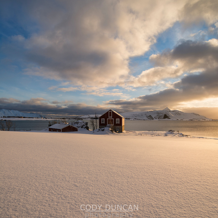Barn in coastal winter landscape, Vestvågøy, Lofoten Islands, Norway