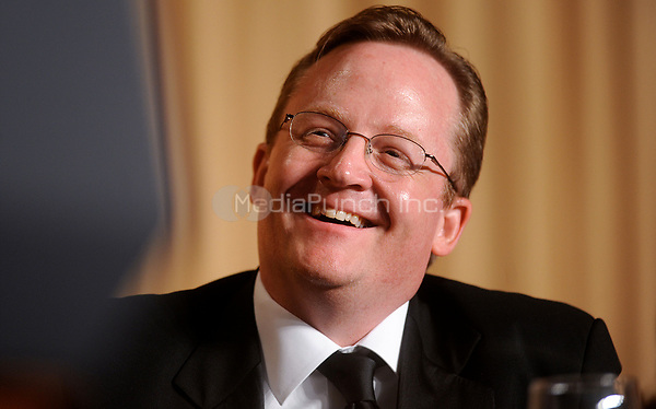 Press Secretary Robert Gibbs smiles during the White House Correspondents' Association Dinner at the Washington Hilton in Washington, DC, on Saturday, May 1, 2010.<br /> Credit: Olivier Douliery / Pool via CNP /MediaPunch