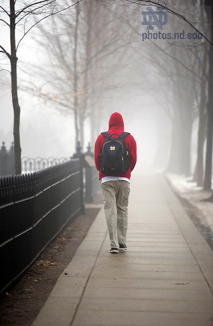 January 17, 2012; Tom Johnson, mechanical engineering student, walks to class through the fog along Notre Dame Avenue. Photo by Barbara Johnston/University of Notre Dame