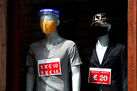 Dummies wearing masks<br /> Roma May 20th 2020. Covid-19 Italy further relaxes lockdown. After Italy further eased the restrictions two days ago, many shops in centre of Rome and near St Peter's basilica, remain closed due to  the lack of tourists and faithfuls. On many closed shutters were put up signs asking the Government an economic help.<br /> Photo Samantha Zucchi Insidefoto