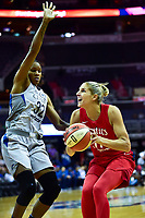 Washington, DC - May 27, 2018: Washington Mystics guard Elena Delle Donne (11)vmakes a move to the basket against Minnesota Lynx forward Rebekkah Brunson (32) during game between the Mystics and Lynx at the Capital One Arena in Washington, DC. (Photo by Phil Peters/Media Images International)
