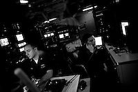 Members of the crew broadcast TV and entartainment progams from the bradcasting center abord the USS Dwight D. Eisenhower (CVN 69), a nuclear powered american aircraft carrier that is currently supporting Operation Enduring Freedom, the american effort in Afghanistan, by sending tens of its jets every day to support ground troops in air to ground bombing operations, on Sunday May 31 2009 at an undisclosed location in the Arabian Sea.