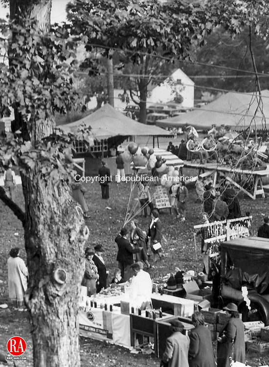 DURHAM - Fair goers enjoy many things in the undated photograph of the Durham Fair.  In the foreground a boy is deciding which ice cream flavor he wants and a man sells balloons while in the background a band is playing on stage.