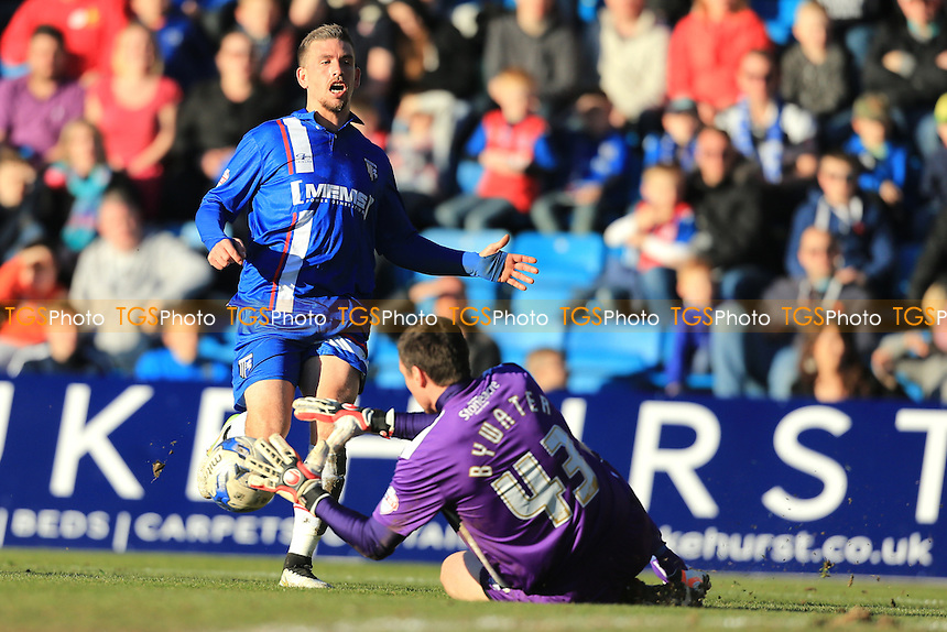 Cody McDonald of Gillingham is not quick enough to beat Stephen Bywater of Doncaster Rovers - Gillingham vs Doncaster Rovers - Sky Bet League One Football at Priestfield Stadium, Gillingham, Kent - 07/03/15 - MANDATORY CREDIT: Simon Roe/TGSPHOTO - Self billing applies where appropriate - contact@tgsphoto.co.uk - NO UNPAID USE