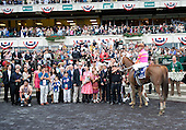 The winning connections celebrate Ruler On ice's win in the Belmont Stakes.