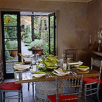 The dining room is located in its own pavilion and looks out over the narrow cobbled garden