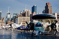 NEW YORK CITY, NY – JULY 9: Aircraft on the flight deck of the USS Intrepid (CV/CVA/CVS-11), one of 24 Essex-class aircraft carriers built during World War II for the United States Navy, on July 9, 2011 in Manhattan, New York City. As of 1982, it has been the foundation of the Intrepid Sea Air Space Museum in New York City.