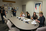 Board members explain the details and amount of their scholarships to Taylor Crofoot and Morgan Crofoot in front of local media during the Nevada Women's Fund Scholarship distribution, June 20, 2019.