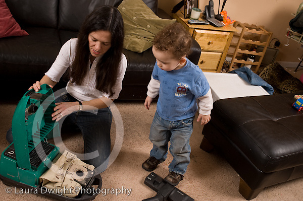 2 year old toddler boy at home with mother interested in appliance vacuum cleaner bag changing language development talked to horizontal