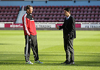 Pictured L-R: Swansea assistant manager Morten Wieghorst with manager Michael Laudrup. 01 February 2014<br /> Re: Barclay's Premier League, West Ham United v Swansea City FC at Boleyn Ground, London.