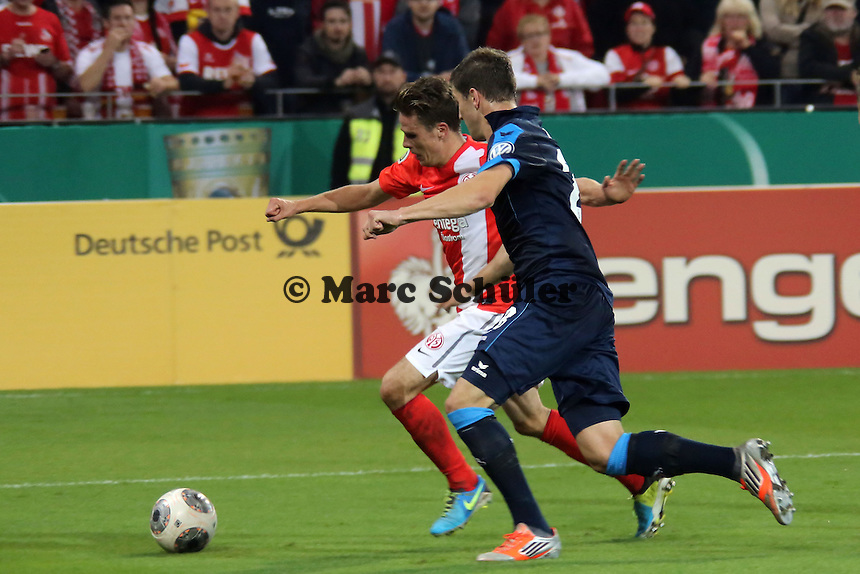 Nicolai Müller (Mainz) gegen Kevin Wimmer (Köln) - 1. FSV Mainz 05 vs. 1. FC Köln, Coface Arena, 2. Runde DFB-Pokal