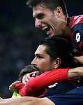 Calcio, Serie A: Lazio vs Genoa. Roma, stadio Olimpico, 23 settembre 2012..Genoa forward Marco Borriello, center, is hugged by teammates after scoring the winning goal during the Italian Serie A football match between Lazio and Genoa at Rome's Olympic stadium, 23 September 2012. Genoa won 1-0..UPDATE IMAGES PRESS/Riccardo De Luca