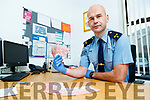 Sgt Tim O'Keeffe with the counterfeit €10 notes at Tralee Garda Station on Wednesday.