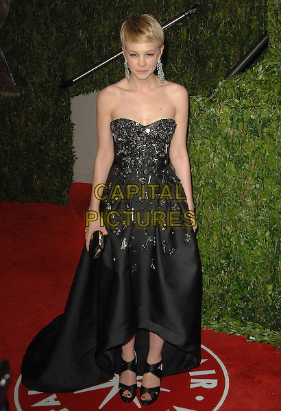 CAREY MULLIGAN.The 2010 Vanity Fair Oscar Party held at The Sunset Tower Hotel in West Hollywood, California, USA..March 7th, 2010.oscars full length dress black strapless beads beaded embellished jewel encrusted .CAP/RKE/DVS.©DVS/RockinExposures/Capital Pictures.