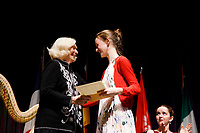Stage IV finalist Mathilde Wauters from Belgium receives the Willy Postma Concerto Prize for the best performance of Joaquin Rodrigo's Concierto de Aranjuez from USA International Harp Competition Founder and Artistic Director Susann McDonald during the awards ceremony of the 11th USA International Harp Competition at Indiana University in Bloomington, Indiana on Saturday, July 13, 2019. (Photo by James Brosher)
