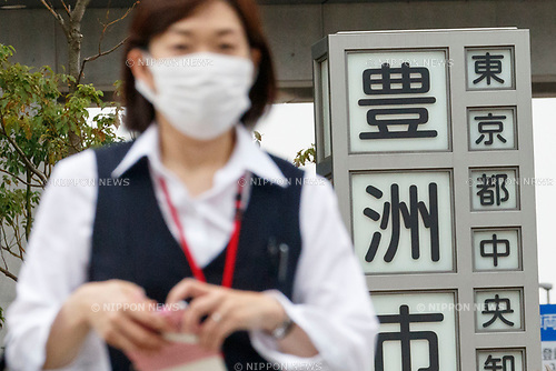 A worker arrives at the new Tokyo Metropolitan Central Wholesale Market which opened in Toyosu on October 11, 2018, Tokyo, Japan. The new fish market replaces the famous Tsukiji Fish Market which closed for the last time on Saturday 6th October. The move to Toyosu was delayed for almost 2 years because of fears over toxins found in water below the new market. (Photo by Rodrigo Reyes Marin/AFLO)