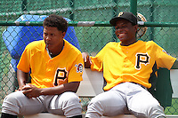 GCL Pirates pitchers Miguel Mendez #99 (left) and Diomedes Mateo #71 sitting in the bullpen during a game against the GCL Braves at Disney Wide World of Sports on June 25, 2011 in Kissimmee, Florida.  The Pirates defeated the Braves 5-4 in ten innings.  (Mike Janes/Four Seam Images)