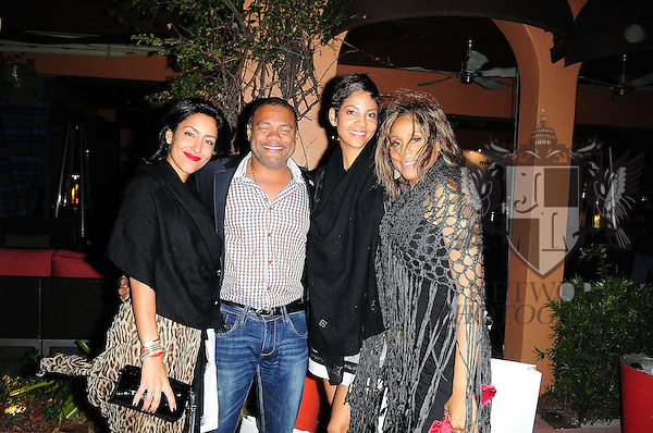 MIAMI BEACH, FL - DECEMBER 02: Guest, Michel-Ange Berret, Tracy Wilson Mourning and Deborah Cox attends Rico Loves birthday party at Vic and Angelo's South Beach on December 2, 2011 in Miami Beach, Florida. (Photo by Johnny Louis/jlnphotography.com)