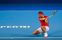 4th January 2020; RAC Arena, Perth, Western Australia; ATP Cup Australia, Perth, Day 2; Spain versus Georgia Rafael Nadal of Spain goes to one knee to hit a backhand shot against Nikoloz Basilashvili of Georgia - Editorial Use