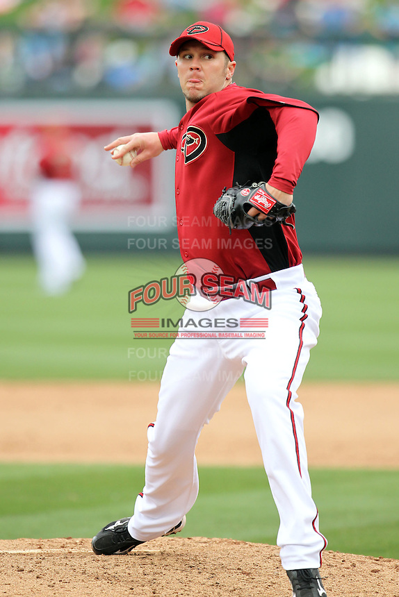 Micah Owings #15 of the Arizona Diamondbacks plays against the Colorado Rockies in the inaugural spring training game at Salt River Fields on February 26, 2011 in Scottsdale, Arizona. .Photo by:  Bill Mitchell/Four Seam Images.