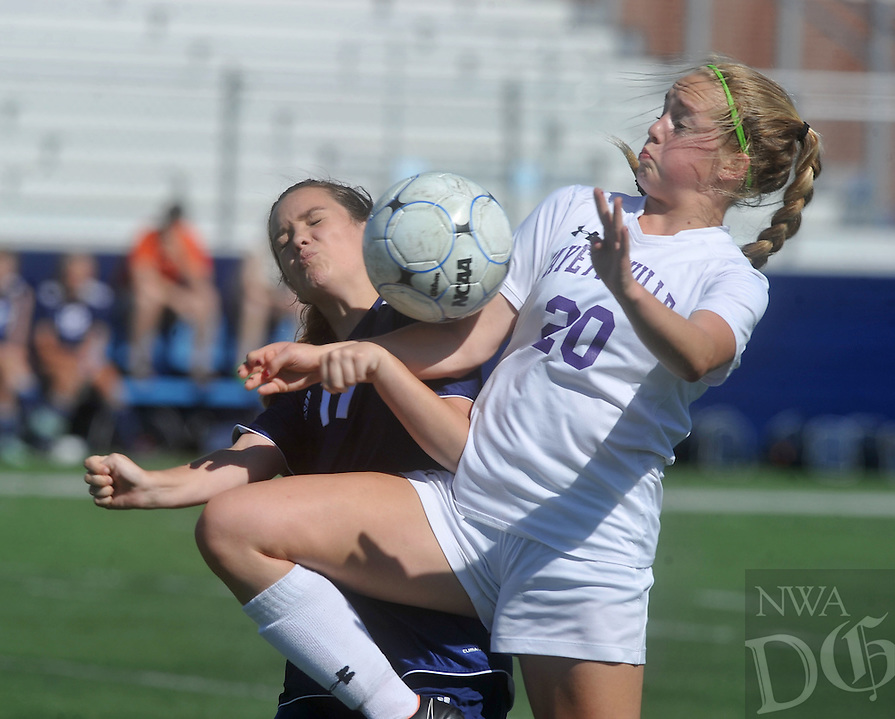NWA Democrat-Gazette/MICHAEL WOODS &bull; @NWAMICHAELW<br /> Myra Tubb (20) from Fayetteville and Felicity Auxier (11) from Heritage go after the ball Friday May 13, 2016 during the 7A State Soccer Tournament at Har-Ber High School in Springdale.